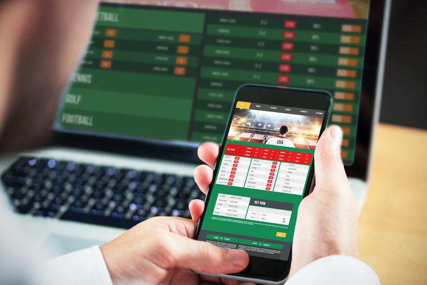 42323913 - businessman using smartphone against gambling app screen